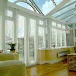 White upvc T-shaped Conservatory by Adam Window Centres, Tuckton